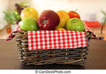 pile of apples in wicker basket