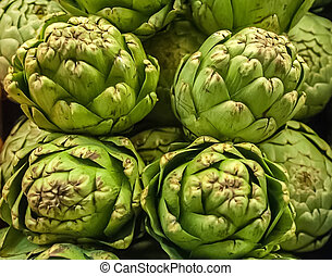 Pile of Artichoke on display at a farmers market