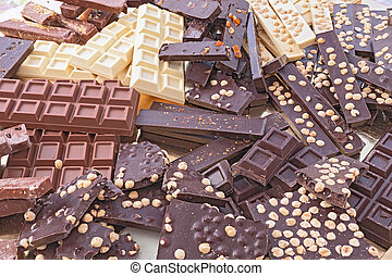 assorted chocolate bars - pile of assorted chocolate bars -...
