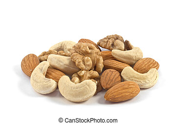 Pile of assorted nuts close up isolated on white background