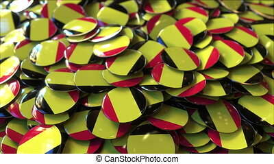 Pile of badges featuring flags of Belgium
