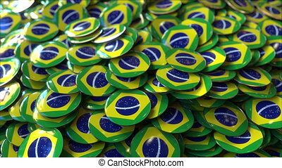 Pile of badges featuring flags of Brazil - Badges featuring...