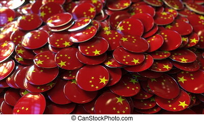 Pile of badges featuring flags of China