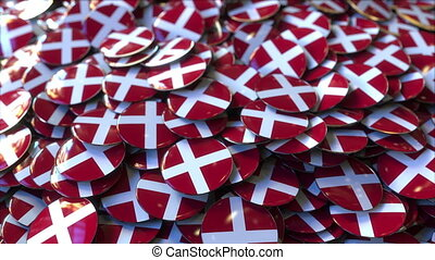 Pile of badges featuring flags of Denmark - Badges featuring...