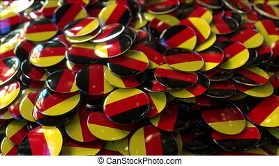 Pile of badges featuring flags of Germany - Badges featuring...