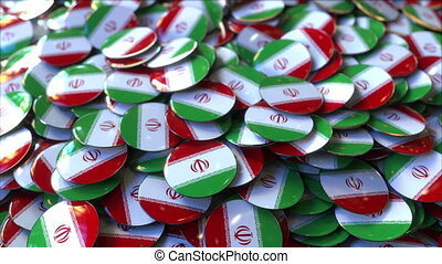 Pile of badges featuring flags of Iran - Badges featuring...