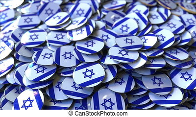 Pile of badges featuring flags of Israel - Badges featuring...