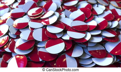 Pile of badges featuring flags of Poland or Monaco - Badges...