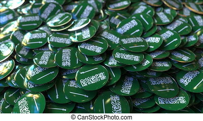 Pile of badges featuring flags of Saudi Arabia - Badges...