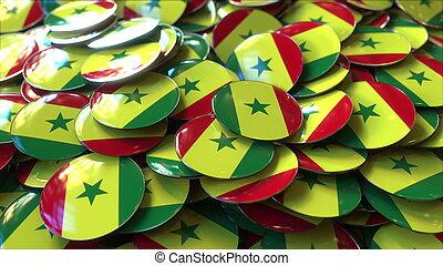 Pile of badges featuring flags of Senegal, 3D rendering