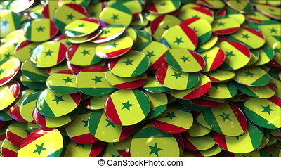 Pile of badges featuring flags of Senegal - Badges featuring...