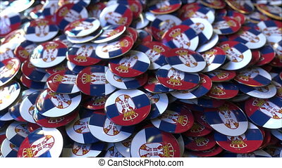 Pile of badges featuring flags of Serbia - Badges featuring...