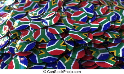 Pile of badges featuring flags of South Africa - Badges...