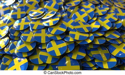 Pile of badges featuring flags of Sweden - Badges featuring...