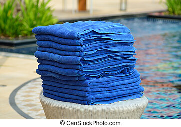 Pile of bath towel near swimming pool. - Pile of bath towel...