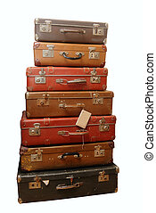Pile of battered old suitcases and trunks in poor condition