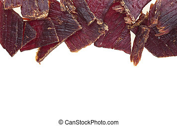 Pile of beef jerky on white background, top view.