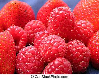 Pile of Berries - Strawberries and raspberries piled...