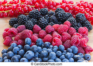 pile of berry mix - pile of bluberry, raspberry, blackberry ...