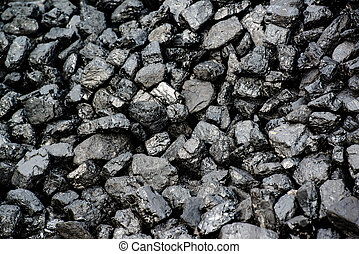 Pile Of Black Coal - A pile of black coal from mining pit -...