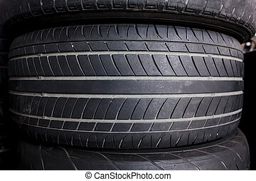 Pile of black used tire