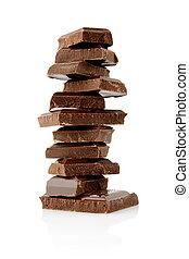 Pile of blocks of chocolate on white background