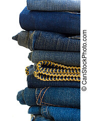 pile of blue jeans close up