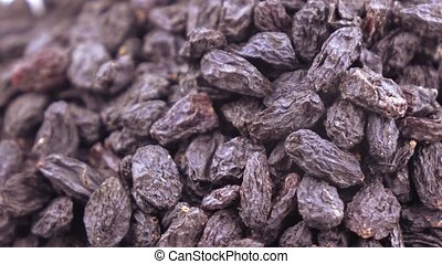 Pile of blue raisins - A pile of dried blue raisins from...