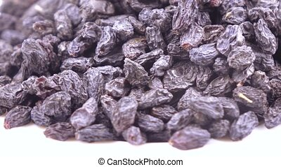 A pile of dried blue raisins from grapes