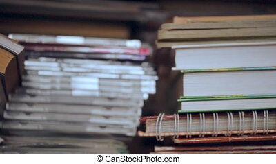 Pile of books and discs on shelf