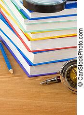 pile of books on wood