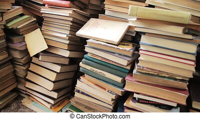Pile of Books Scattered on the Floor in the Library