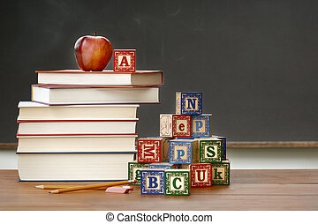 Pile of books with wooden blocks