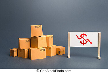 Pile of boxes and easel with red dollar arrow down chart. Drop profits, sales slowdown. Decrease in trade volumes, commodity prices. Unprofitable business, adverse conditions for production investment