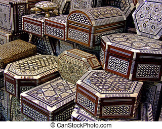 Bunch of handicraft wooden boxes selling on a market