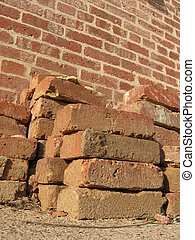 Pile Of Bricks 1 - A pile of red bricks in front a brick ...