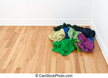 Pile of bright clothes in the room corner