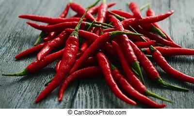 Pile of bright red chili peppers - Closeup shot of bright...