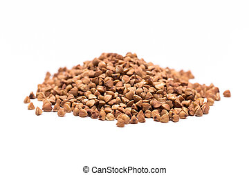 Pile of buckwheat isolated on white background. Top view.