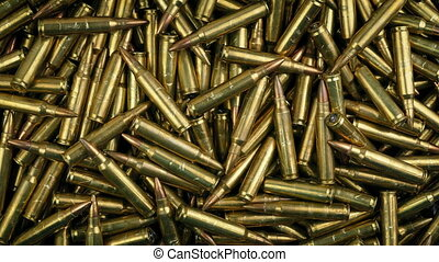 Pile Of Bullets Rotating From Above