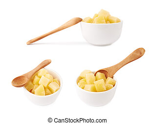 Pile of canned pineapple over isolated white background