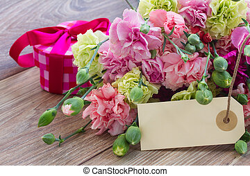 carnation flowers with empty tag