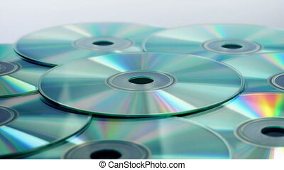 Pile Of CDs Rotating - CD disks rotating closeup