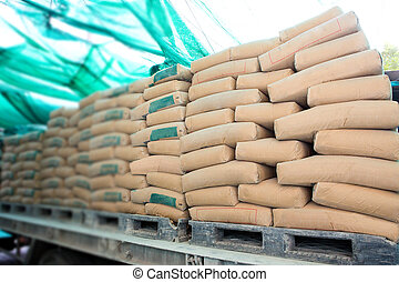 Pile of Cement in bags,neatly stacked for a construction...