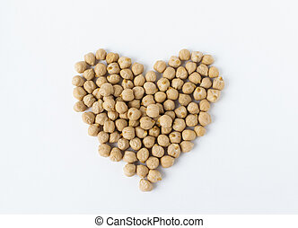 Pile of chickpeas on white background. Garbanzo beans traditional Near Easten food. Heart shape.