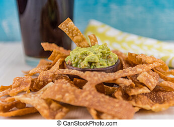 Pile of Chips Surround Guacamole