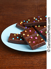 chocolate fudge brownies on a blue plate