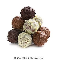 pile of chocolate truffles on white bacgkround