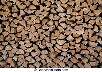 Pile of chopped fire wood prepared for winter - texture