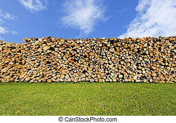 Pile of Chopped Firewood on Blue Sky - Dry chopped firewood ...
